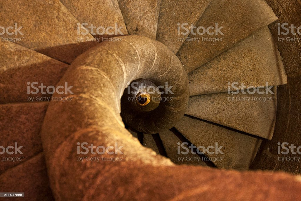 Stone spiral staircase in the tower stock photo