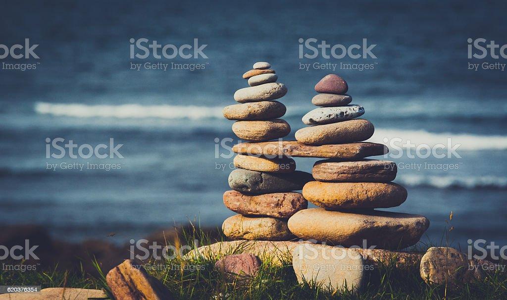 Stone stacks on the seashore stock photo