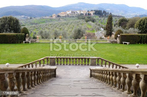 Ancient staircase,in the distance an old village,Artimino,Florence,Tuscany,Italy.