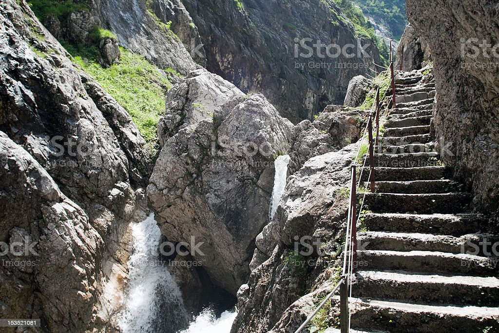 Stone stairs in the Höllental canyon to Mt. Zugspitze royalty-free stock photo