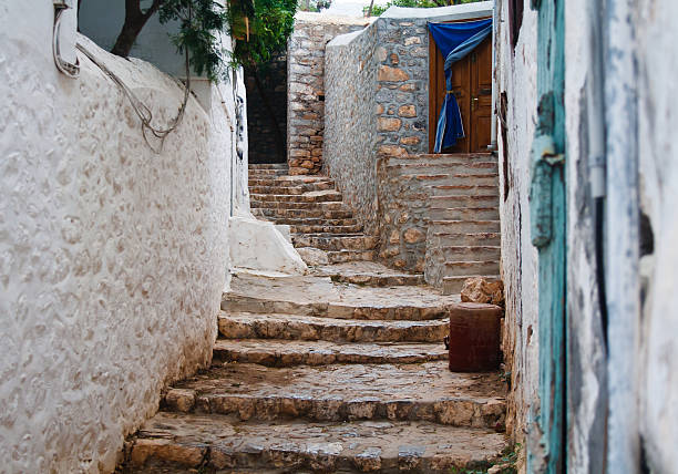 """Stone stairs """"Traditional stone stairs in Hydra island, Greece"""" rymdraket stock pictures, royalty-free photos & images"""