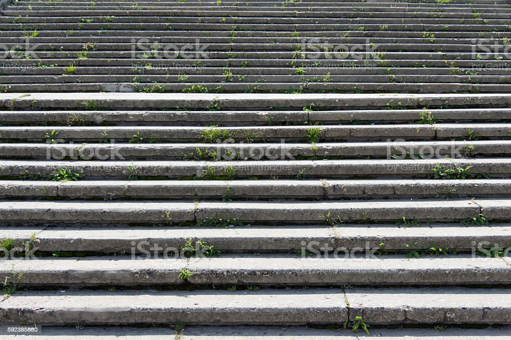 Stone (concrete) stairs with lots of steps. The light falls stock photo