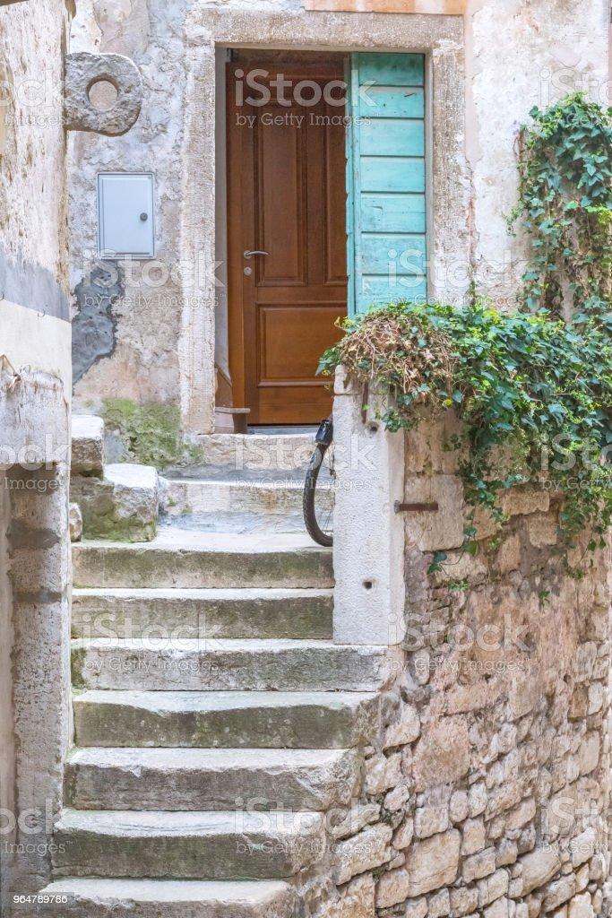Stone stairway to entrance door of an old house in Rovinj. royalty-free stock photo