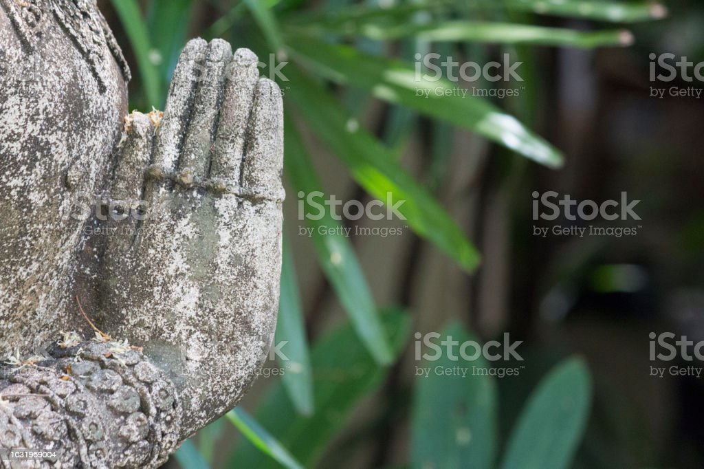 stone statue detail of human hand in chiang mai ,thailand. stock photo