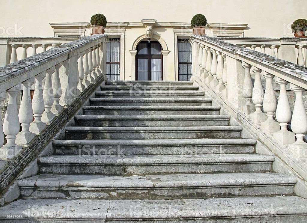 stone steps leading to the entrance of a villa stock photo