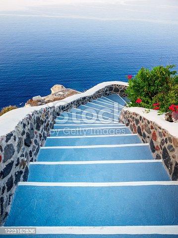 Stone steps, road to sea. Santorini island view. Cyclades, Greece.