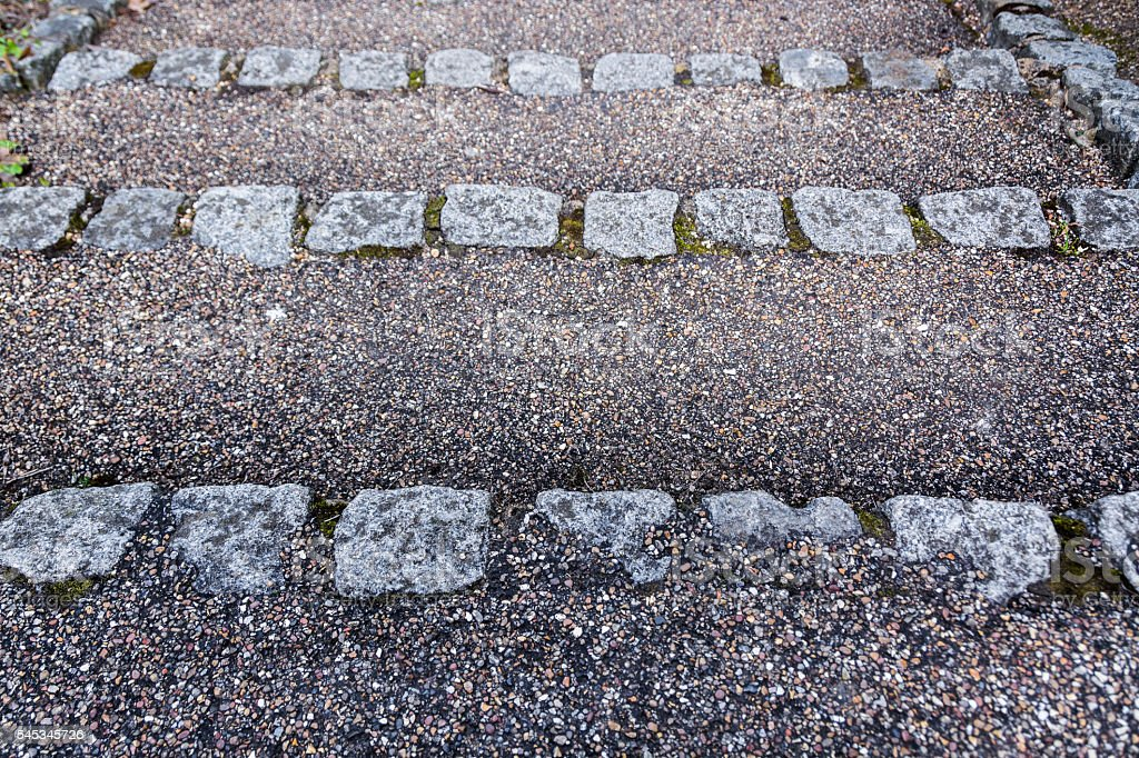 Stone steps with gravel texture - downwards stock photo