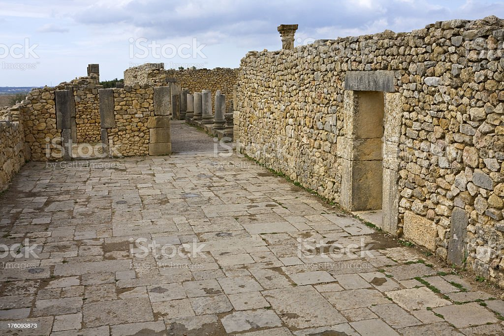 Stone street and wall, Roman ruin at Volubulis, Morocco stock photo