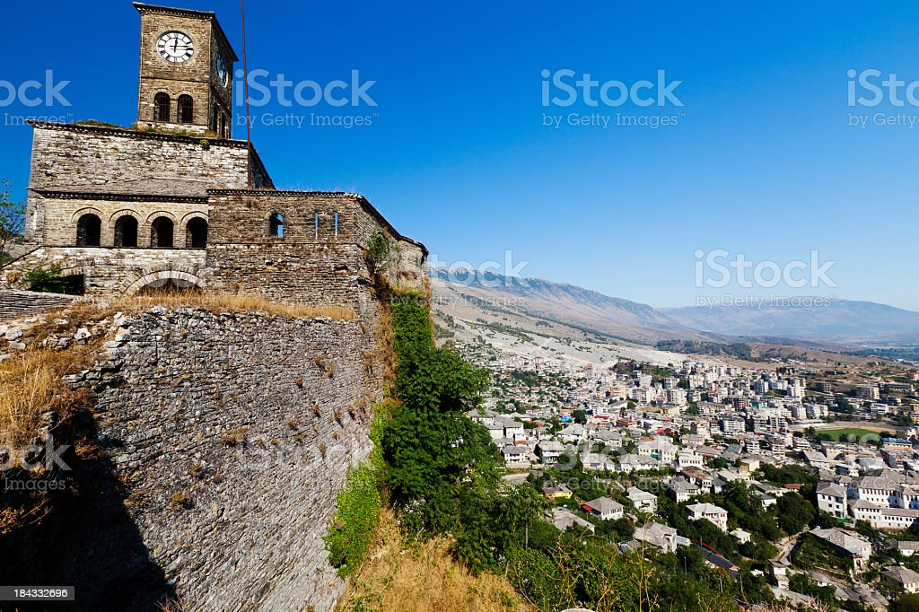 Stone structure on hill overlooking town stock photo