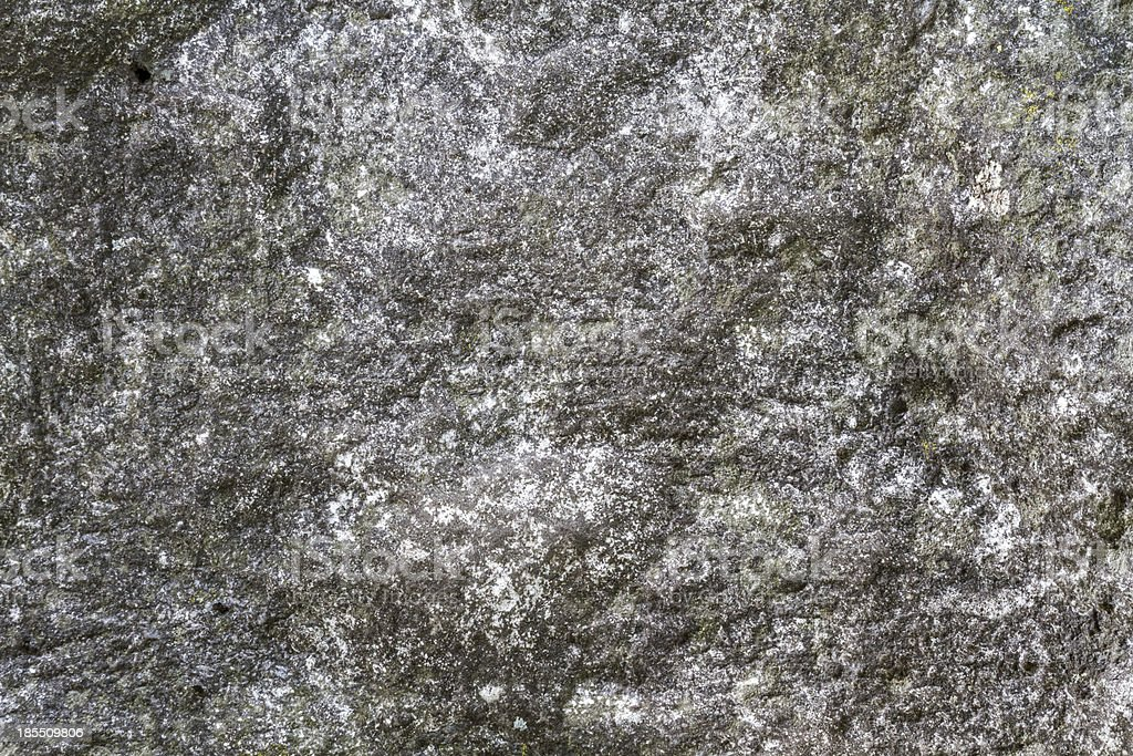 Stone surface with moss texture weather beaten royalty-free stock photo