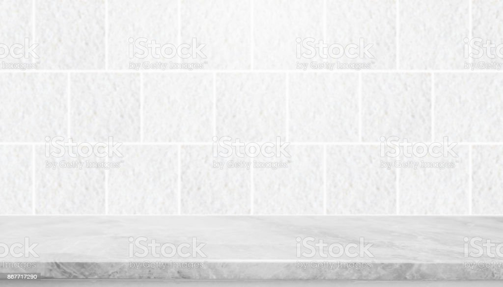 Stone table top and background of grey granite stone tile wall - can used for display or montage your products. stock photo