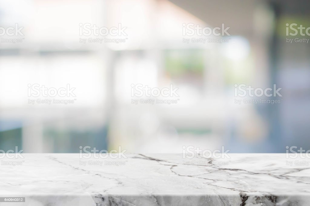 Stone table top and blurred bokeh background with vintage filter - can used for display or montage your products. stock photo