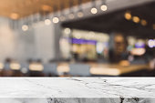 istock Stone table top and blurred bokeh cafe and coffee shop interior background with vintage filter - can used for display or montage your products. 691441086