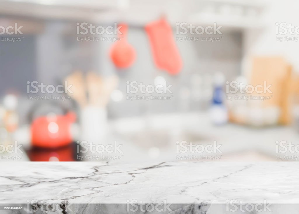 Stone table top and blurred kitchen interior background. stock photo