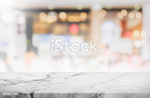 662984906istockphoto Stone table top and blurred restaurant interior background - can used for display or montage your products. 655651592