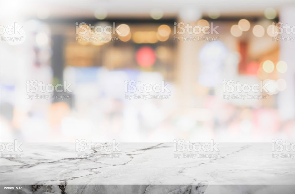 Stone table top and blurred restaurant interior background - can used for display or montage your products. stock photo
