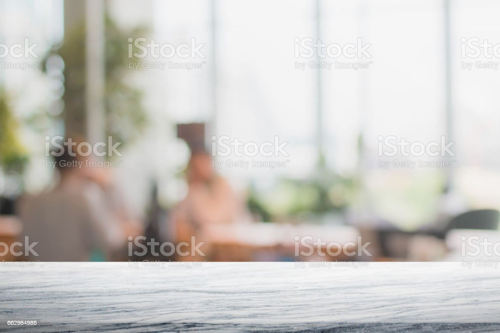 Stone table top and blurred restaurant interior background stock photo
