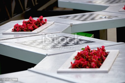 istock Stone tables with chess boards for playing chess outdoors in the Park. Leisure and entertainment for visitors to the Park. 1217132668