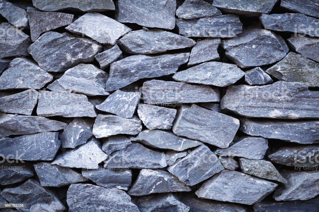 Steen textuur of steen achtergrond. steen voor interieur, exterieur decoratie en conceptontwerp van industriële bouw. steen motieven die natuurlijke optreedt. - Royalty-free Achtergrond - Thema Stockfoto