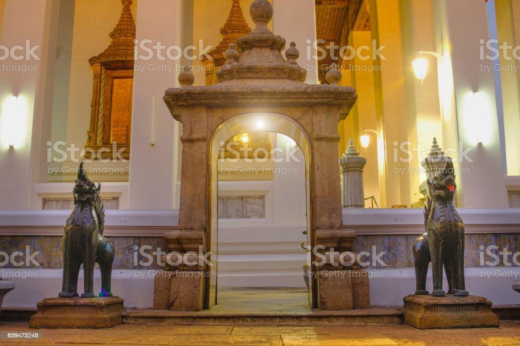 Stone Thai-Chinese style sculpture and  thai door art architecture stock photo