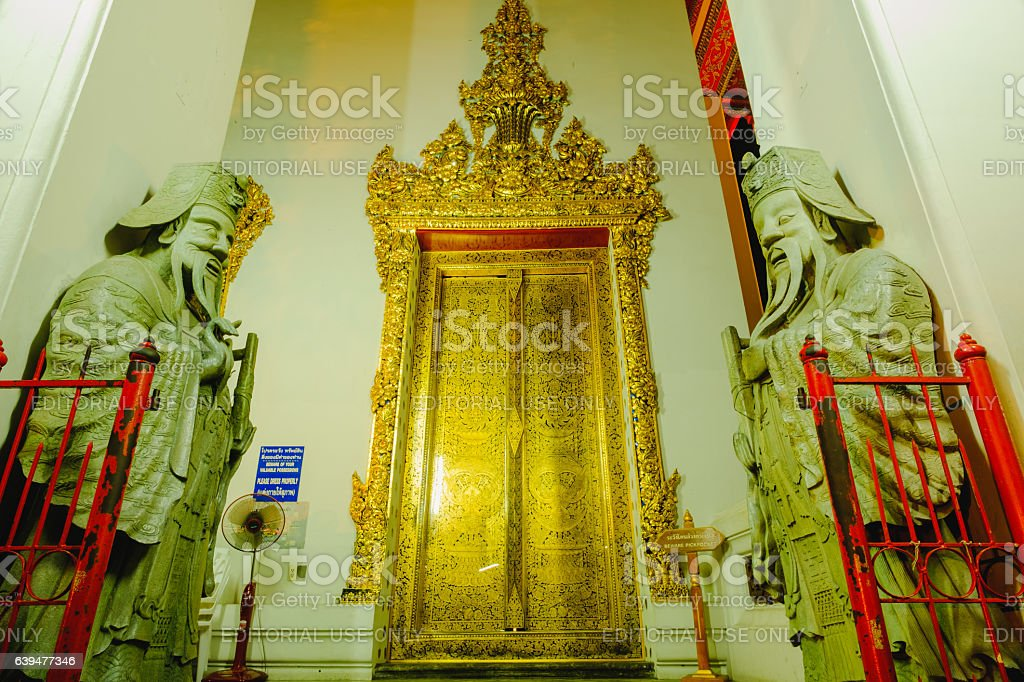 Stone Thai-Chinese style sculpture and  thai door. stock photo