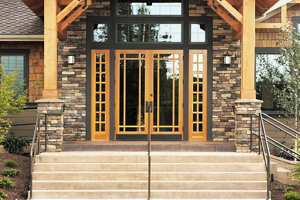 Stone Timber Architecture Entrance Contemporary stone timber and glass architecture building facade and entrance steps. half timbered stock pictures, royalty-free photos & images
