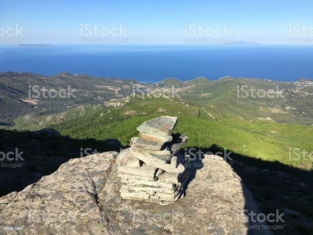 Stone tower at the top of the mountain. Cap Corse. Corsica. stock photo