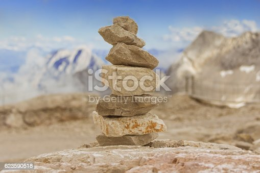 istock Stone tower in mountains height show balance stability power 623590518