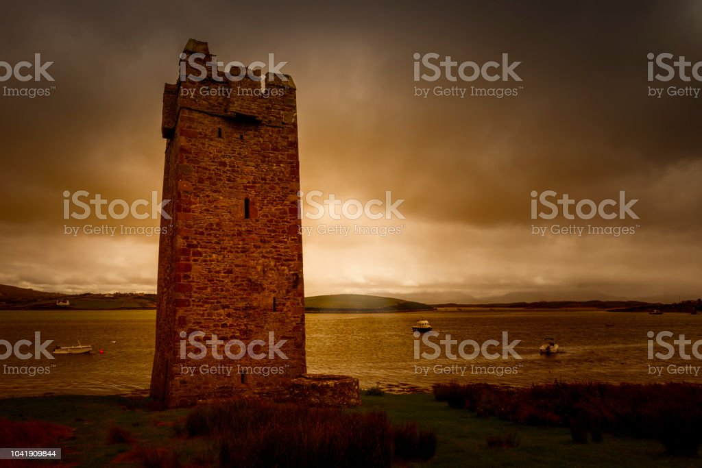 stone tower in typical landscape in Ireland stock photo