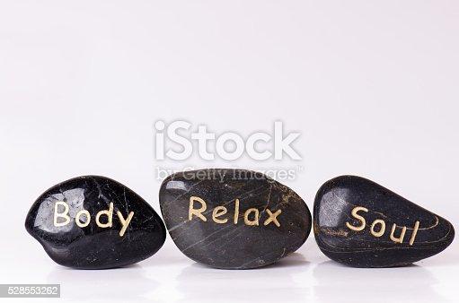 istock Stone treatment. Black massaging stones isolated on a white background. 528553262