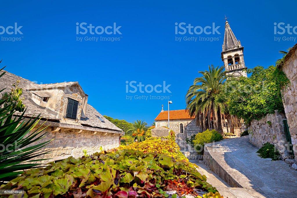 Stone village of Splitska church and street stock photo
