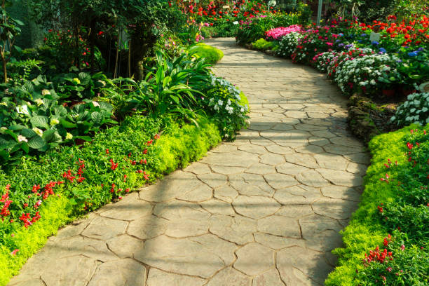 Stone walkway in flower garden. Stone walkway in flower garden. Annual flower exhibition in Chiang Mai, Thailand. landscaped stock pictures, royalty-free photos & images
