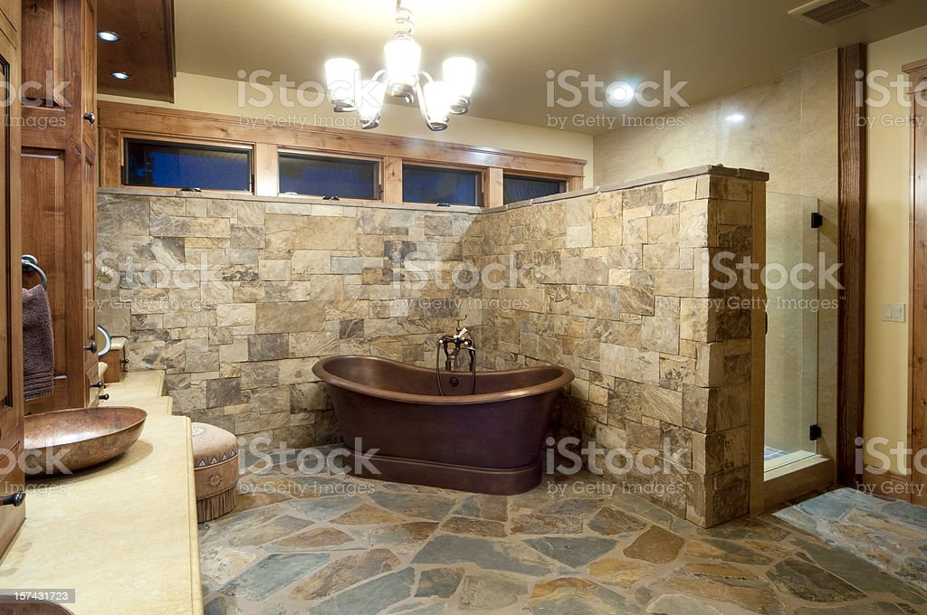 Stone Wall And Floor Bathroom With Brown Freestanding Bath Stock ...