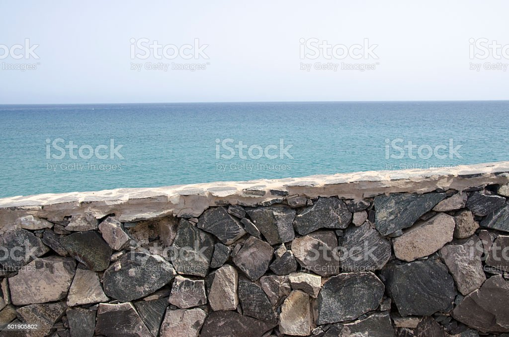 Stone Wall And Sea stock photo