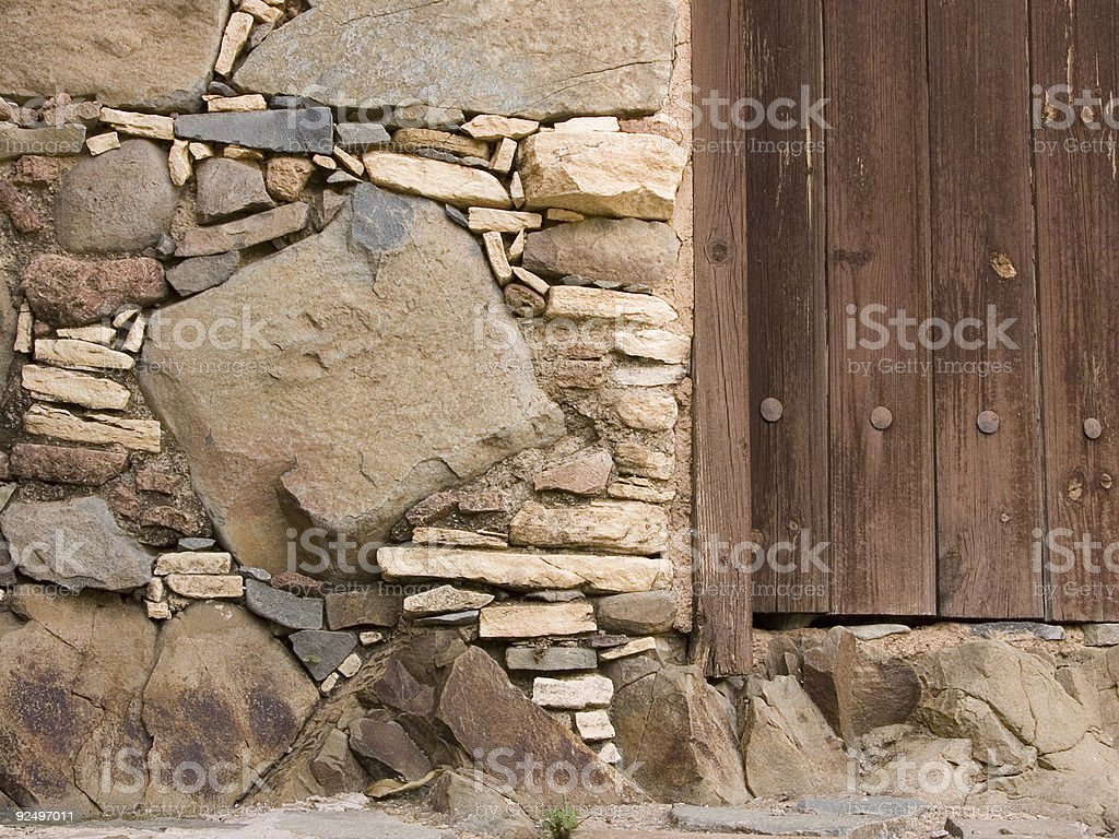 Stone wall and wooden door royalty-free stock photo