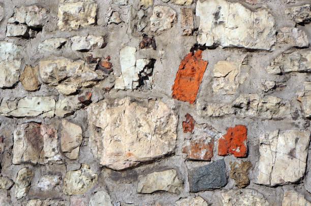 stone wall. architectural background. - historycyzm zdjęcia i obrazy z banku zdjęć