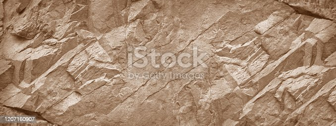 istock Stone wall background. Light brown rock texture. Stone grunge backdrop. 1207160907