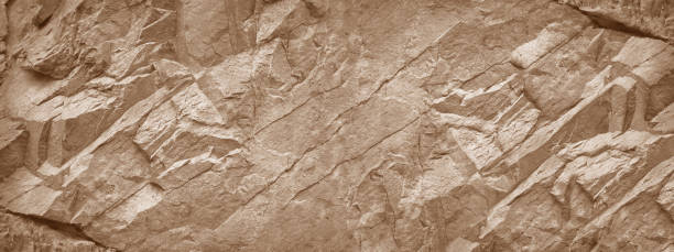 Stone wall background. Light brown rock texture. Stone grunge backdrop. Rocky texture banner with copy space for your design. marble rock stock pictures, royalty-free photos & images