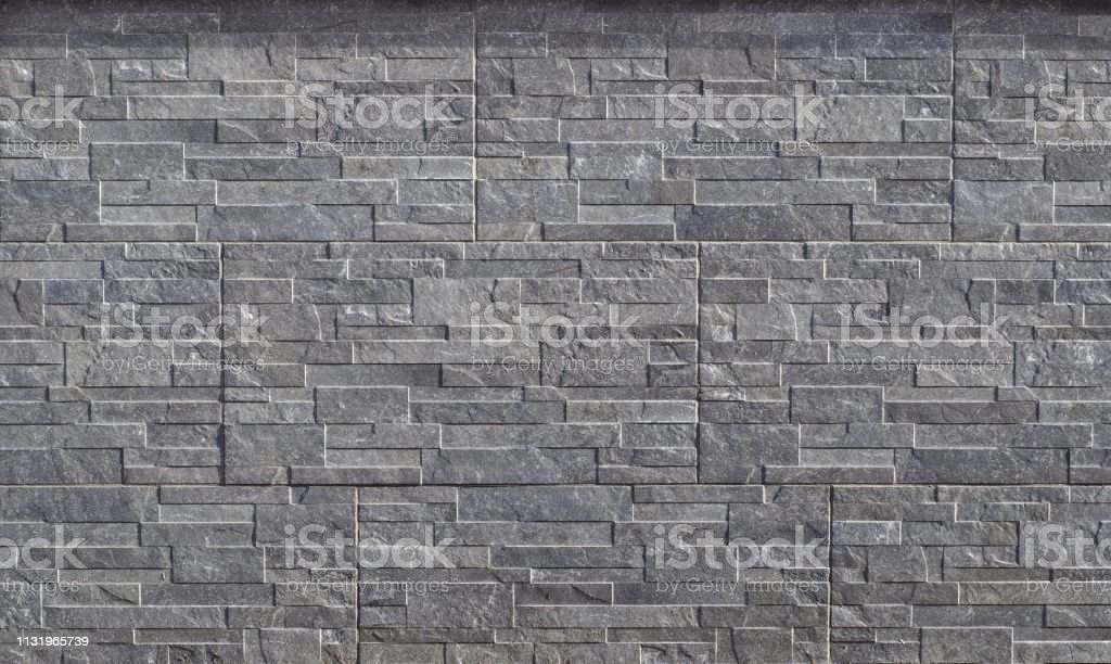 Stone Wall Cladding Made Of Embossed Horizontal Gray Stripes Of Rock Stacked In Panels Stock Photo Download Image Now Istock