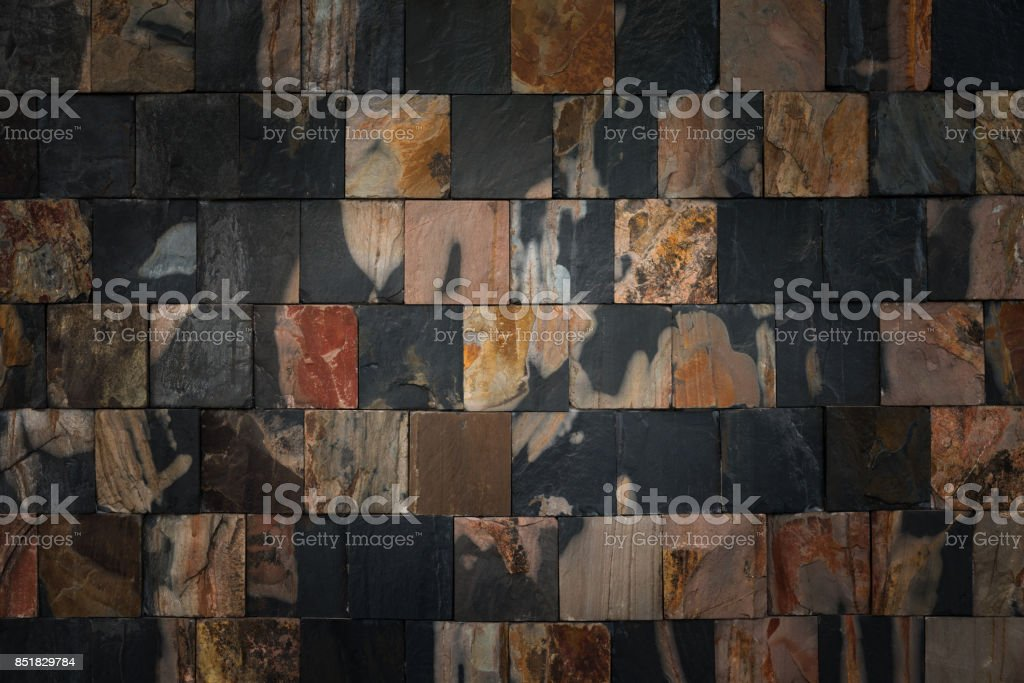Stone wall for background and texture, Abstract puzzle stone wall backgrund and texture stock photo