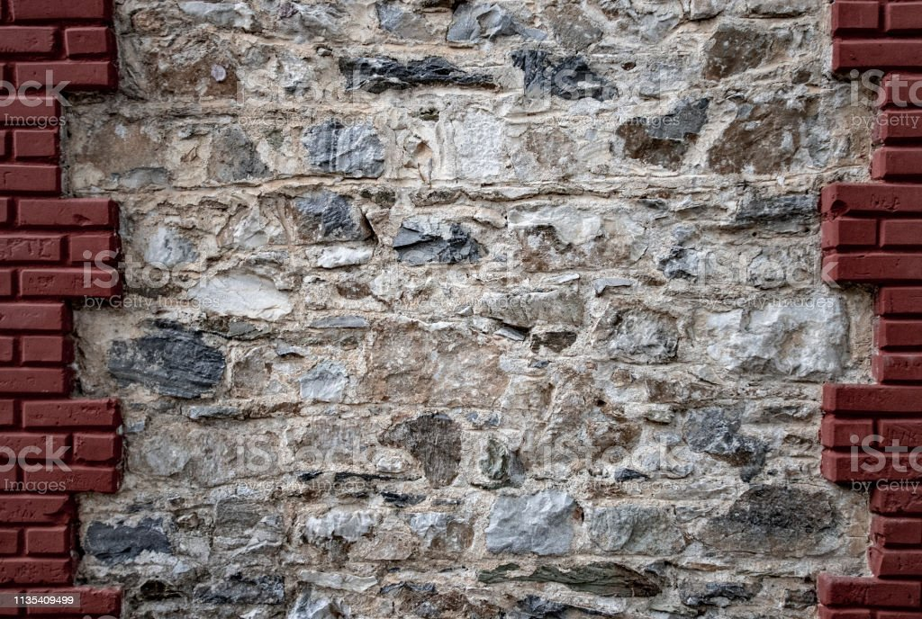 stone wall framed with tile. Stony textured background