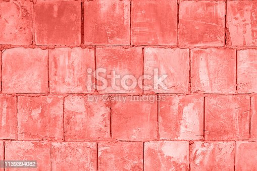 istock Stone wall of square blocks, coral toned. Background Texture 1139394082
