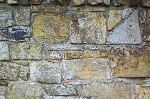 A stone wall in random geometric shapes