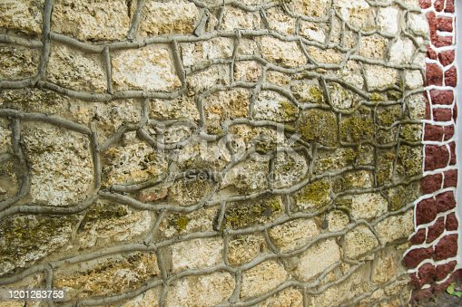 old big stone wall in the street