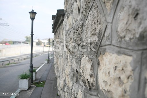 Part of a stone wall  facing the street