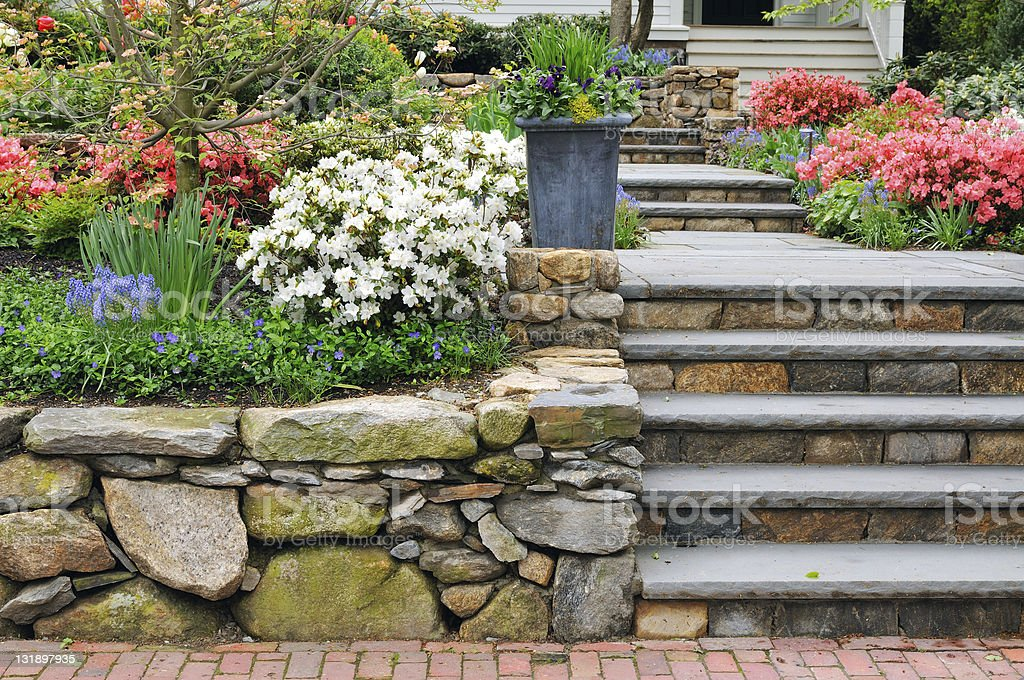 Stone Wall, Steps and Planter on Colorful Garden stock photo