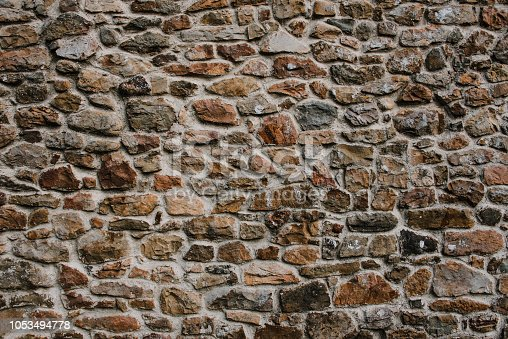 An old wall made of stone background / texture