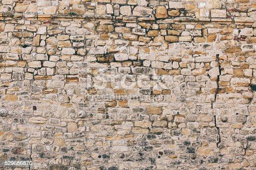 istock Stone wall texture 529686870