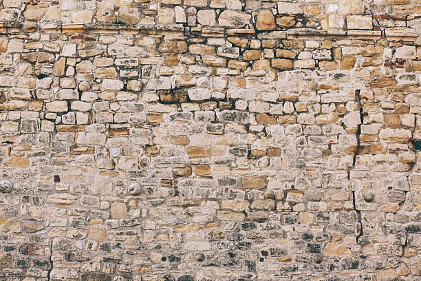 stone wall texture - ancient stock photos and pictures