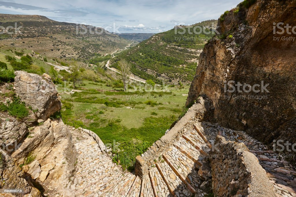 Stone wall walk and green landscape in Teruel. Spain stock photo
